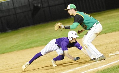 CHS junior Noah Hughes dives back to first base.