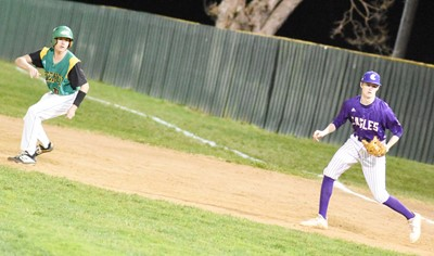 CHS sophomore Tristin Faulkner keeps the runner close at first.
