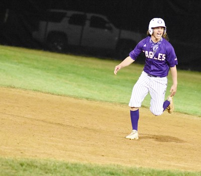 CHS senior Treyce Mattingly celebrates as he runs the bases after hitting a home run.
