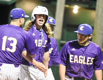 CHS senior Treyce Mattingly celebrates with his teammates after hitting a home run.