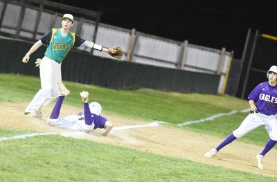 CHS junior Blake Allen dives back to third base, as sophomore John Orberson runs back to second.