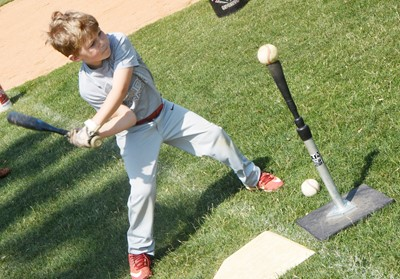 Campbellsville Elementary School first-grader Landry Brown hits the ball.