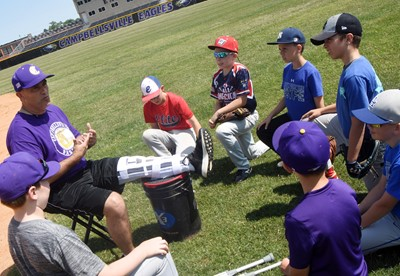 CHS baseball assistant coach Lynn Kearney talks to campers about playing in the outfield.