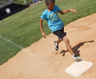 Campbellsville Elementary School second-grader Tyce Owens practices running to first.