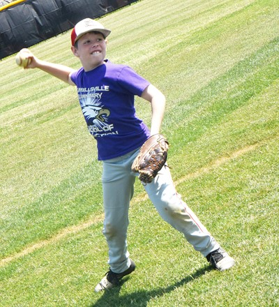 Campbellsville Elementary School third-grader Brody Sidebottom catches and throws the ball.
