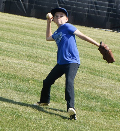 Campbellsville Elementary School fifth-grader Brayden Judd catches and throws the ball.