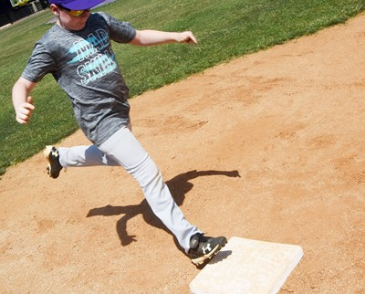 Campbellsville Elementary School fourth-grader Stephen Green practices running to first.