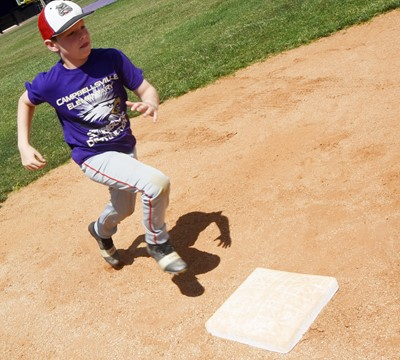 Campbellsville Elementary School third-grader Brody Sidebottom practices running to first.