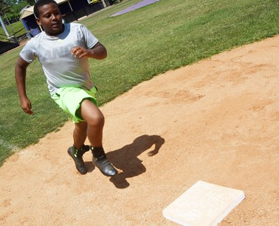 Campbellsville Middle School sixth-grader KeKe Miller practices running to first.