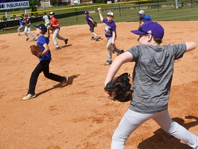 CHS baseball youth camp participants practice throwing.