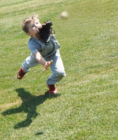 Campbellsville Elementary School first-grader Landry Brown runs to catch the ball.