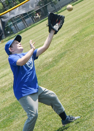 Campbellsville Elementary School second-grader Ryne Gumm catches the ball.
