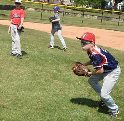 Campbellsville Elementary School fourth-grader Lanigan Price fields the ball.