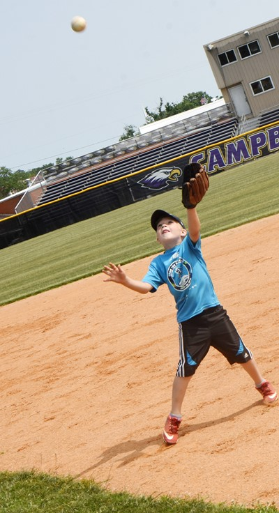 Campbellsville Elementary School first-grader Landry Brown catches the ball.