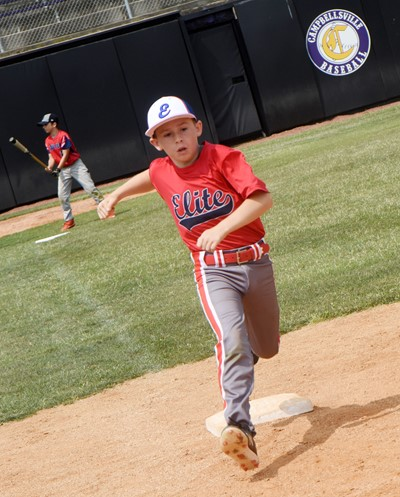 Campbellsville Elementary School fourth-grader Lanigan Price practices running to first.