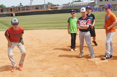 Campbellsville Elementary School fifth-grader Carson Mills practices getting a lead toward third.