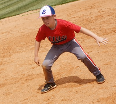 Campbellsville Elementary School fourth-grader Lanigan Price practices getting a lead toward third.