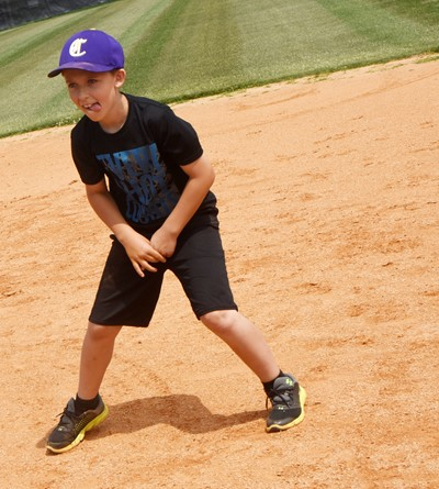 Campbellsville Elementary School third-grader Aiden Forrest practices getting a lead toward third.