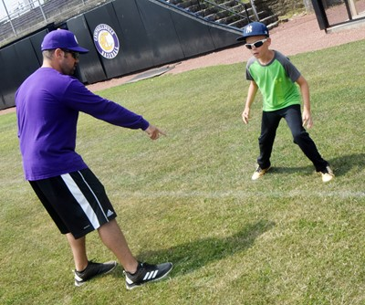 CHS baseball head coach Blake Milby helps Campbellsville Elementary School fifth-grader Brayden Judd as he learns to run the bases.