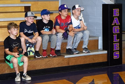 CHS baseball youth campers listen as coaches talk to them about the rules of baseball. From left are Campbellsville Elementary School first-grader Landry Brown, second-graders Kennon Davis and Ryne Gumm and fifth-graders Carson Mills and Cameron Estes.