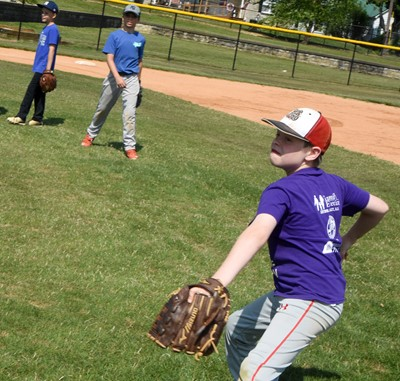 Campbellsville Elementary School fourth-grader Stephen Green fields the ball and throws to first.