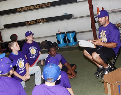 CHS baseball head coach Blake Milby talks to youth campers.