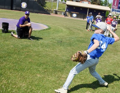 Campbellsville Elementary School fifth-grader Cameron Estes fields the ball and throws to first.