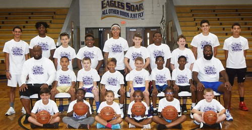 Campbellsville High School boys' basketball team recently hosted a youth camp, with about 20 attending. From left, front, are Campbellsville Middle School sixth-grader Easton Williams, Campbellsville Elementary School fourth-grader Destini Gholston, Ila Loy, CES first-grader Daya Griffin, CES fourth-grader Willow Griffin and CES third-grader Grif Thomas. Second row, CHS boys' basketball head coach Anthony Epps, CES fifth-grader Maddox Hawkins, CMS sixth-grader Keaton Hord, CES fifth-grader Rajon Taylor, CMS sixth-grader Cameron Estes, Jameson Hines, CES fifth-grader Jaron Johnson and CHS boys' basketball assistant coach Will Griffin. Back, CHS senior basketball players Mikael Vaught and Malachi Corley, Grayson Booe, CMS sixth-grader Austin Sloan, Epps's daughter Makayla, CES fifth-grader Aidan Wilson, CMS seventh-grader KeKe Miller, CMS sixth-grader Izak Burress, CHS junior Kameron Smith and sophomore Brice Spaw.