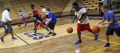 CHS boys' basketball head coach Anthony Epps leads a drill with campers.