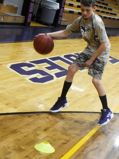 Campbellsville Elementary School fifth-grader Aidan Wilson dribbles during a drill.