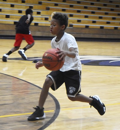 Campbellsville Elementary School fifth-grader Rajon Taylor dribbles during a drill.