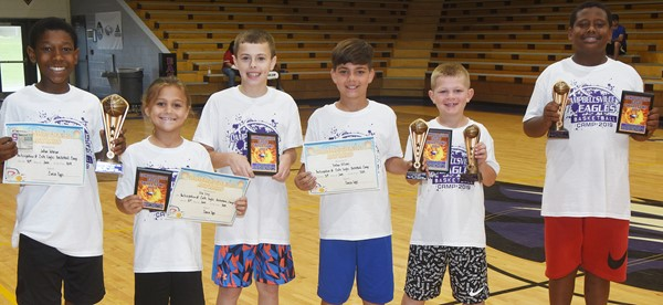 Campbellsville High School boys' basketball team recently hosted a youth camp, with about 20 attending. Award winners are, from left, Campbellsville Elementary School fifth-grader Jaron Johnson, Coaches Camper award; Ila Loy, Coach Epps award; CES sixth-grader Keaton Hord, Spot Shooting award; CES sixth-grader Easton Williams, Free Throw award; CES third-grader Grif Thomas, Free Throw and Spot Shooting awards; and CMS seventh-grader KeKe Miller, Free Throw and Spot Shooting awards.