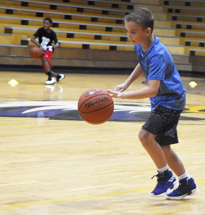 Campbellsville Middle School sixth-grader Cameron Estes dribbles during a drill.