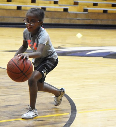 Campbellsville Elementary School first-grader Daya Griffin dribbles during a drill.