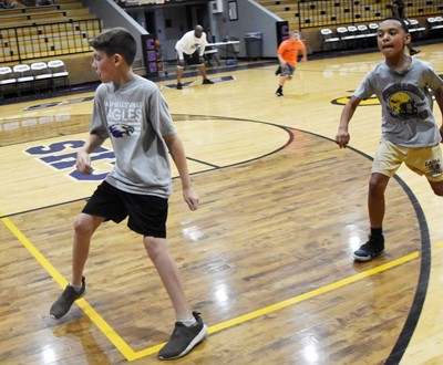 Campbellsville Middle School fifth-graders Aidan Wilson, at left, and Maddox Hawkins run during a drill.