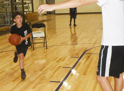 Campbellsville Middle School sixth-grader Easton Williams goes to the basket during a drill.