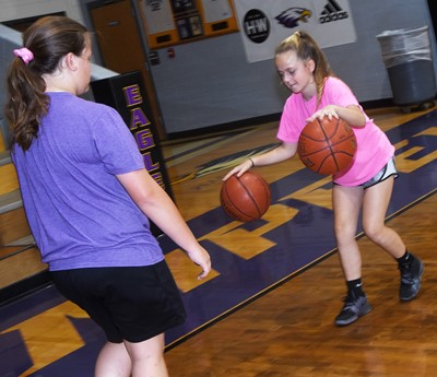 Campbellsville Middle School sixth-grader Keeley Dicken, at left, and Campbellsville Elementary School fifth-grader Kennedy Griffiths practice dribbling.