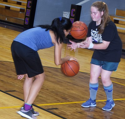Campbellsville Elementary School fifth-grader Aleecia Knezevic, at left, and Campbellsville Middle School seventh-grader Layla Steen practice their ball handling.