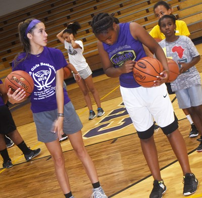 CHS girls' basketball player and freshman Kaylyn Smith helps Campbellsville Middle School sixth-grader Ta'Zaria Owens as she practices shooting.