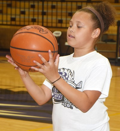 Campbellsville Elementary School fifth-grader Alexis Graves practices shooting.