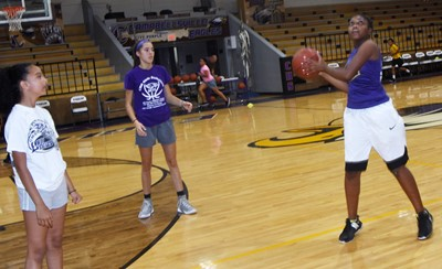 Campbellsville Middle School sixth-grader Ta'Zaria Owens shoots the ball as she takes on Campbellsville Elementary School fifth-grader Alyssa Knezevic in a game of one-on-one. In center is CHS girls' basketball player and freshman Kaylyn Smith.