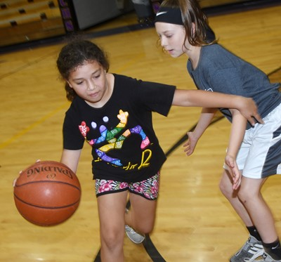 Campbellsville Elementary School third-grader Ammarissa Nunez, at left, and Kennedy Deener play a game of one-on-one.