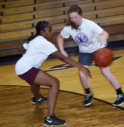 Campbellsville Middle School sixth-graders Ta'Zaria Owens, at left, and Miley Hash play one-on-one.