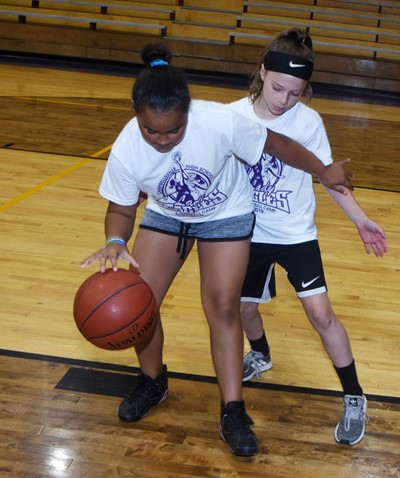 Campbellsville Elementary School third-grader Maleigha Travis, at left, takes on Kennedy Deener in a game of one-on-one.