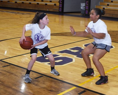 Kennedy Deener, at left, takes on Campbellsville Elementary School third-grader Maleigha Travis in a game of one-on-one.