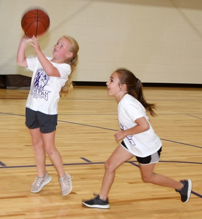 Campbellsville Elementary School second-graders Lillie Judd, at left, and Aubrey Allen play a game of one-on-one.