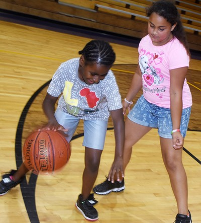 Campbellsville Elementary School third-graders Destini Gholston, at left, and Maleigha Travis play one-on-one.