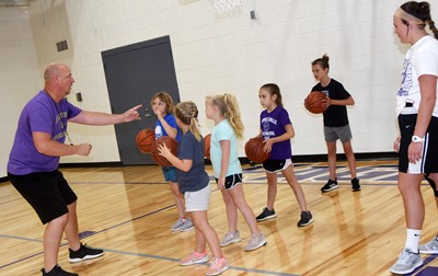 CHS girls' basketball head coach David Petett talks to campers in the youth division.