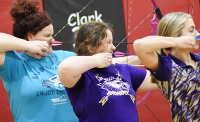 From left, CHS senior Shallan Philpott, Campbellsville Middle School sixth-grader Madison Philpott and eighth-grader Braelyn Price take aim.