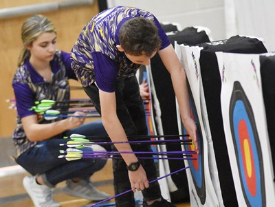 Campbellsville Middle School seventh-grader Noah Leachman pulls his arrows from the target.